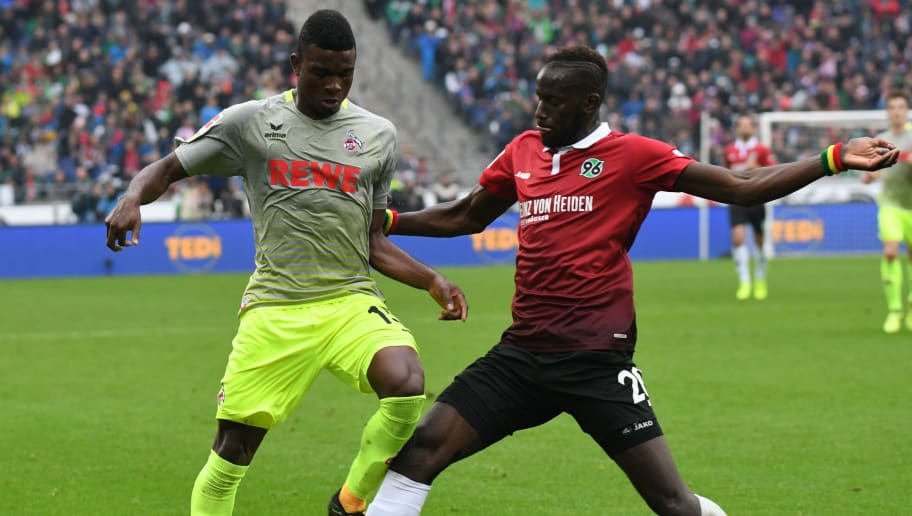 Hanover's Senegalese defender Salif Sane (R) and Cologne's Colombian forward Jhon Cordoba vie for the ball during the German first division Bundesliga football match Hanover 96 vs 1 FC Cologne in Hanover, central Germany on September 24, 2017. / AFP PHOTO / dpa / Peter STEFFEN / NO Getty Images (GETTY-VD) - Germany OUT / RESTRICTIONS: DURING MATCH TIME: DFL RULES TO LIMIT THE ONLINE USAGE TO 15 PICTURES PER MATCH AND FORBID IMAGE SEQUENCES TO SIMULATE VIDEO. == RESTRICTED TO EDITORIAL USE == FOR FURTHER QUERIES PLEASE CONTACT DFL DIRECTLY AT + 49 69 650050  /         (Photo credit should read PETER STEFFEN/AFP/Getty Images)