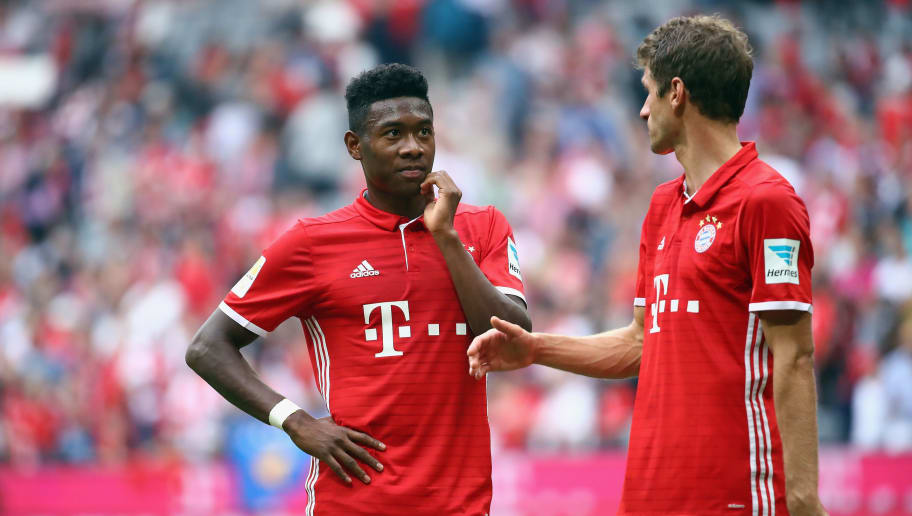 MUNICH, GERMANY - OCTOBER 01: David Alaba (L) and Thomas Mueller m react after the Bundesliga match between Bayern Muenchen and 1. FC Koeln at Allianz Arena on October 1, 2016 in Munich, Germany.  (Photo by Alex Grimm/Bongarts/Getty Images)