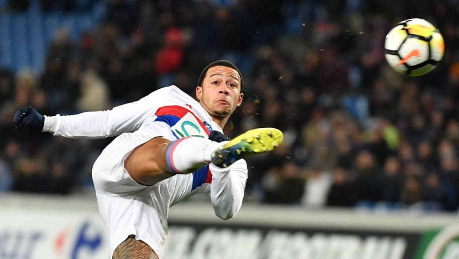Lyon's Dutch forward Memphis Depay kicks the ball during the French Cup round of 8 football match Montpellier vs Lyon on February 7, 2018 at the La Mosson stadium in Montpellier, Southern France. / AFP PHOTO / PASCAL GUYOT        (Photo credit should read PASCAL GUYOT/AFP/Getty Images)
