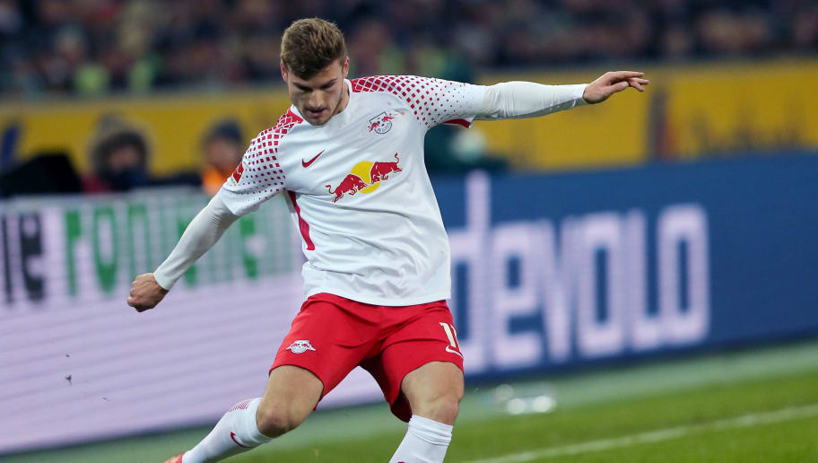 MOENCHENGLADBACH, GERMANY - FEBRUARY 03: Timo Werner of Leipzig runs with the ball during the Bundesliga match between Borussia Moenchengladbach and RB Leipzig at Borussia-Park on February 3, 2018 in Moenchengladbach, Germany. (Photo by Christof Koepsel/Bongarts/Getty Images)