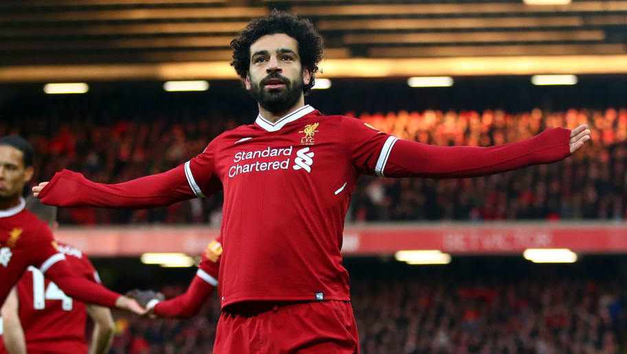 LIVERPOOL, ENGLAND - FEBRUARY 04:  Mohamed Salah of Liverpool celebrates after scoring his sides first goal during the Premier League match between Liverpool and Tottenham Hotspur at Anfield on February 4, 2018 in Liverpool, England.  (Photo by Clive Brunskill/Getty Images)