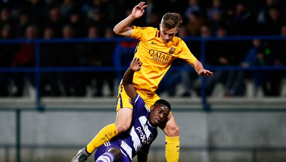 DENDERLEEUW, BELGIUM - MARCH 08:  Orel Mangala of Anderlecht battles for the ball with Oriol Busquets Mas of Barcelona during the UEFA Youth League Quarter-final match between Anderlecht and Barcelona held at Van Roy Stadium on March 8, 2016 in Denderleeuw, Belgium.  (Photo by Dean Mouhtaropoulos/Getty Images)