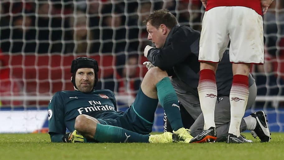 Arsenal's Czech goalkeeper Petr Cech receives medical attention during the English Premier League football match between Arsenal and Everton at the Emirates Stadium in London on February 3, 2018.  / AFP PHOTO / IKIMAGES / Ian KINGTON / RESTRICTED TO EDITORIAL USE. No use with unauthorized audio, video, data, fixture lists, club/league logos or 'live' services. Online in-match use limited to 45 images, no video emulation. No use in betting, games or single club/league/player publications.  /         (Photo credit should read IAN KINGTON/AFP/Getty Images)