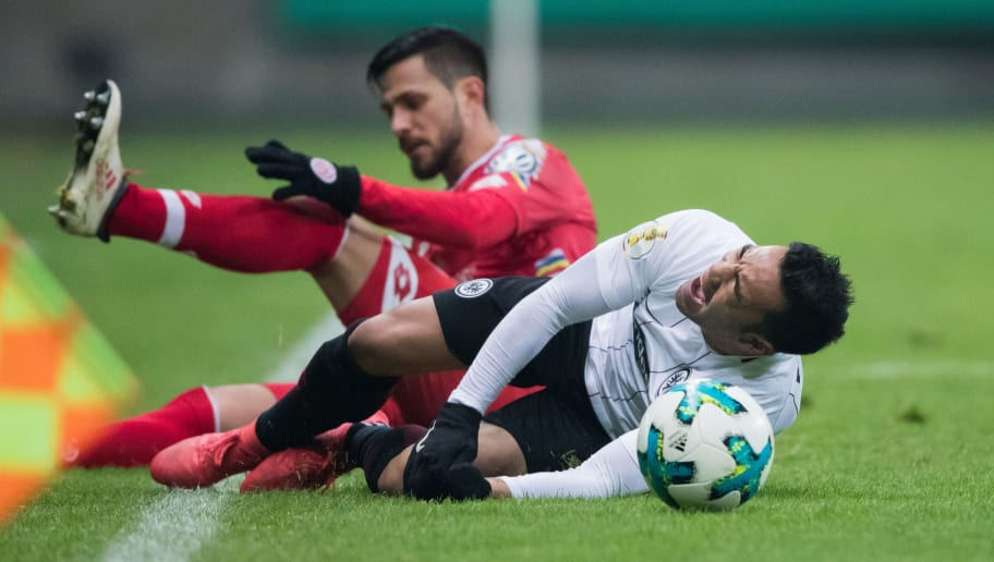 FRANKFURT AM MAIN, GERMANY - FEBRUARY 07: Marco Fabian of Frankfurt is fouled by Danny Latza of Mainz during the DFB Cup quarter final match between Eintracht Frankfurt and 1. FSV Mainz 05 at Commerzbank-Arena on February 7, 2018 in Frankfurt am Main, Germany. (Photo by Simon Hofmann/Bongarts/Getty Images)