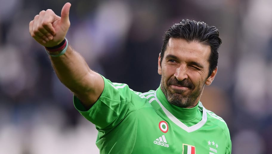 TOPSHOT - Juventus' goalkeeper Gianluigi Buffon celebrates at the end of the Italian Serie A football match between Juventus and Sassuolo on February 4, 2018 at the 'Allianz Stadium' in Turin.  / AFP PHOTO / MARCO BERTORELLO        (Photo credit should read MARCO BERTORELLO/AFP/Getty Images)
