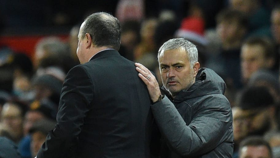 Manchester United's Portuguese manager Jose Mourinho (R) shakes hands with Newcastle United's Spanish manager Rafael Benitez (L) at the end of the English Premier League football match between Manchester United and Newcastle at Old Trafford in Manchester, north west England, on November 18, 2017. / AFP PHOTO / Oli SCARFF / RESTRICTED TO EDITORIAL USE. No use with unauthorized audio, video, data, fixture lists, club/league logos or 'live' services. Online in-match use limited to 75 images, no video emulation. No use in betting, games or single club/league/player publications.  /         (Photo credit should read OLI SCARFF/AFP/Getty Images)