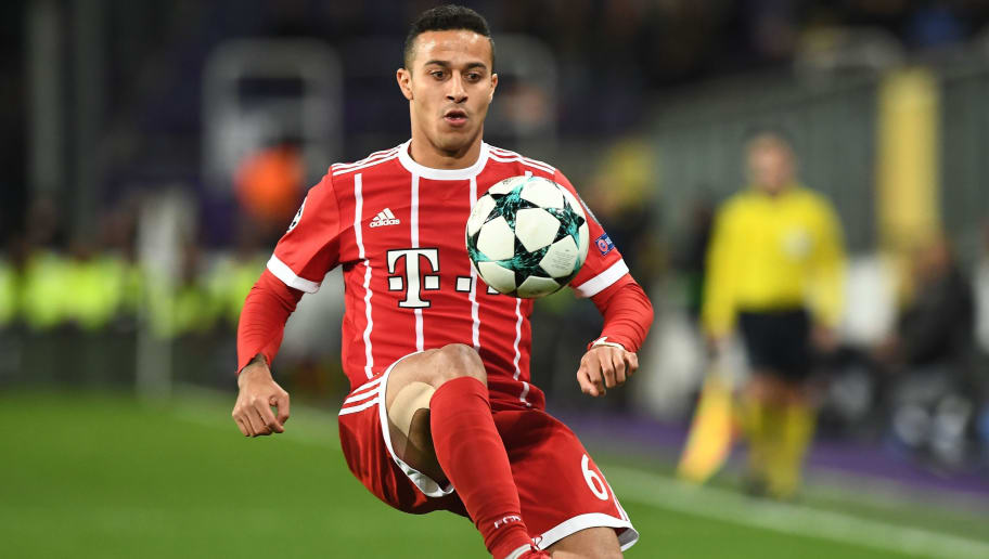 Bayern Munich's Spanish midfielder Thiago Alcantara controls the ball during the UEFA Champions League Group B football match between Anderlecht and Bayern Munich at Constant Vanden Stock Stadium in Brussels on November 22, 2017.  / AFP PHOTO / Emmanuel DUNAND        (Photo credit should read EMMANUEL DUNAND/AFP/Getty Images)