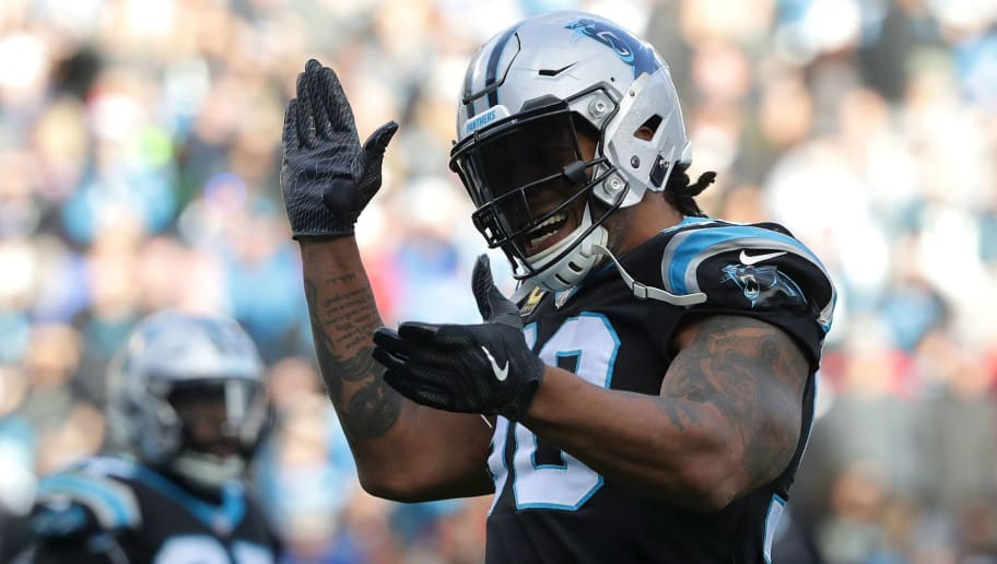 CHARLOTTE, NC - DECEMBER 24:  Julius Peppers #90 of the Carolina Panthers reacts after a play against the Tampa Bay Buccaneers during their game at Bank of America Stadium on December 24, 2017 in Charlotte, North Carolina.  (Photo by Streeter Lecka/Getty Images)