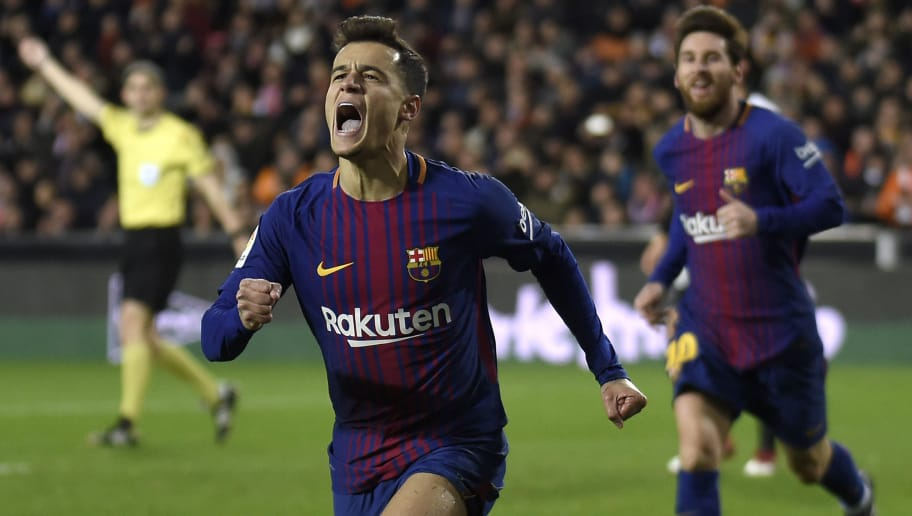 Barcelona's Brazilian midfielder Philippe Coutinho celebrates a goal as Barcelona's Argentinian forward Lionel Messi approaches during the Spanish 'Copa del Rey' (King's cup) second leg semi-final football match between Valencia CF and FC Barcelona at the Mestalla stadium in Valencia on February 8, 2018. / AFP PHOTO / JOSE JORDAN        (Photo credit should read JOSE JORDAN/AFP/Getty Images)