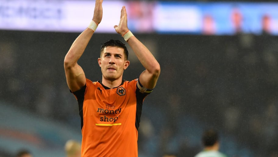 Wolverhampton Wanderers' English defender Danny Batth allauds supporters after the penalty shoot-out in the English League Cup fourth round football match between Manchester City and Wolverhampton Wanderers at the Etihad Stadium in Manchester, north west England, on October 24, 2017. The game ended 0-0 after extra time. Manchester City won 4-1 on penalties. / AFP PHOTO / Anthony DEVLIN / RESTRICTED TO EDITORIAL USE. No use with unauthorized audio, video, data, fixture lists, club/league logos or 'live' services. Online in-match use limited to 75 images, no video emulation. No use in betting, games or single club/league/player publications.  /         (Photo credit should read ANTHONY DEVLIN/AFP/Getty Images)