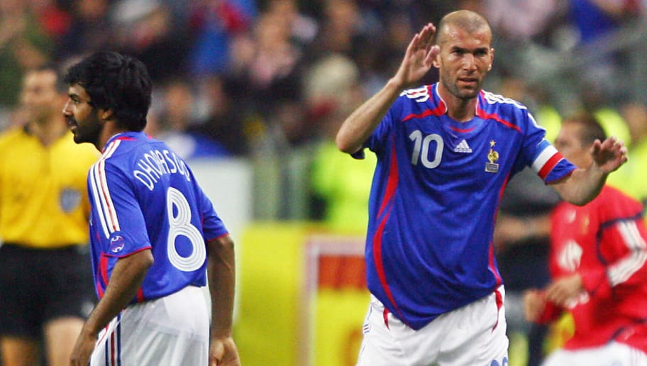 Saint-Denis, FRANCE:  France's Zinedine Zidane (R) leaves the field to be reaplaced by Vikash Dhorasoo (L) during the friendly test match France vs. Mexico, ahead of the 2006 World Cup, 27 May 2006 at the Stade de France in Saint-Denis, north of Paris.    AFP PHOTO/OMAR TORRES  (Photo credit should read OMAR TORRES/AFP/Getty Images)
