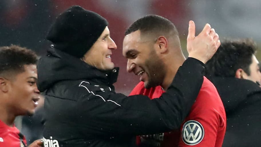 LEVERKUSEN, GERMANY - FEBRUARY 06: Head coach Heiko Herrlich embraces Jonathan Tag of Leverkusen after the DFB Cup quarter final match between Bayer Leverkusen and Werder Bermen at BayArena on February 6, 2018 in Leverkusen, Germany. The match between Leverkusen and Bremen ende 4-2 after extra time. (Photo by Christof Koepsel/Bongarts/Getty Images)