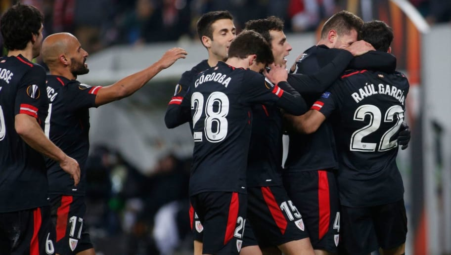 Athletic Bilbao players celebrate with teammate Raul Garcia (R) after he scored during the UEFA Europa League Group J football match between Zorya Luhansk and Athletic Bilbao in Lviv on December 7, 2017. / AFP PHOTO / ANATOLII STEPANOV        (Photo credit should read ANATOLII STEPANOV/AFP/Getty Images)