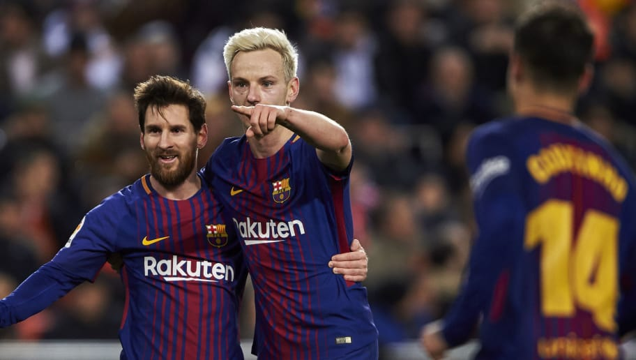 VALENCIA, SPAIN - FEBRUARY 08:  Ivan Rakitic of FC Barcelona celebrates with Lionel Messi after scoring his team's second goal during the Copa de Rey semi-final second leg match between Valencia and Barcelona on February 8, 2018 in Valencia, Spain.  (Photo by Manuel Queimadelos Alonso/Getty Images)