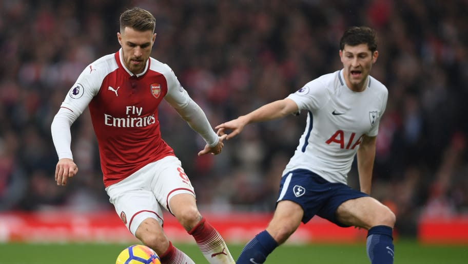 LONDON, ENGLAND - NOVEMBER 18:  Aaron Ramsey of Arsenal is challenged by Ben Davies of Tottenham during the Premier League match between Arsenal and Tottenham Hotspur at Emirates Stadium on November 18, 2017 in London, England.  (Photo by Mike Hewitt/Getty Images)