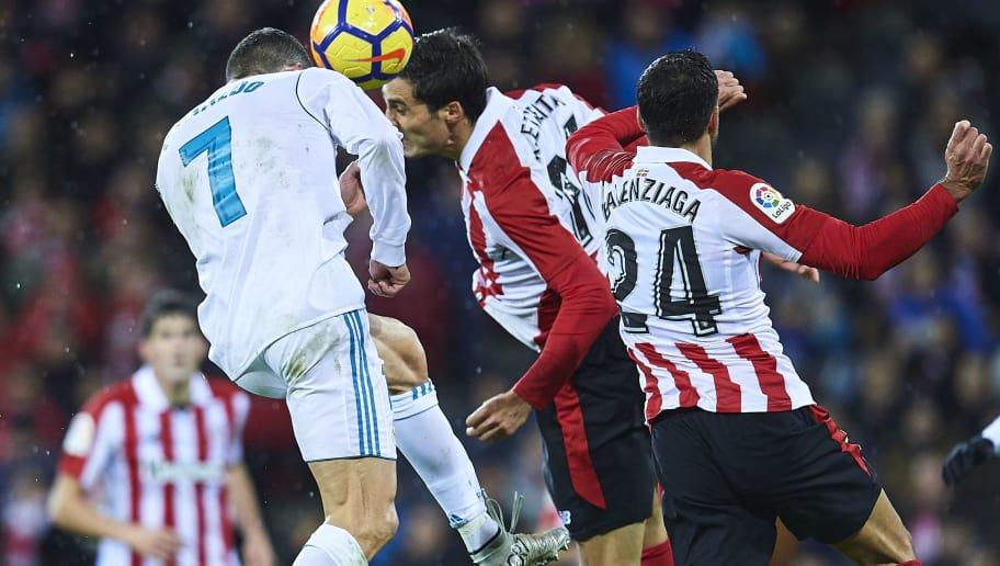 BILBAO, SPAIN - DECEMBER 02:  Cristiano Ronaldo of Real Madrid CF (L) competes for the ball with Xavier Etxeita of Athletic Club (R) during the La Liga match between Athletic Club and Real Madrid at Estadio de San Mames on December 2, 2017 in Bilbao, Spain.  (Photo by Juan Manuel Serrano Arce/Getty Images)
