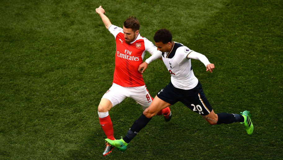 LONDON, ENGLAND - APRIL 30:  Aaron Ramsey of Arsenal and Dele Alli of Tottenham Hotspur battle for possession during the Premier League match between Tottenham Hotspur and Arsenal at White Hart Lane on April 30, 2017 in London, England.  (Photo by Dan Mullan/Getty Images)