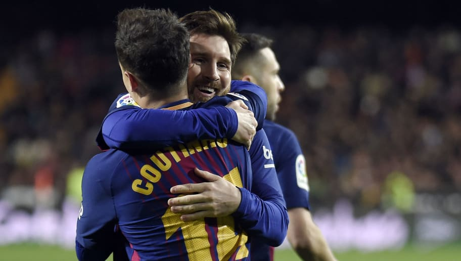 Barcelona's Brazilian midfielder Philippe Coutinho (L) celebrates a goal with Barcelona's Argentinian forward Lionel Messi during the Spanish 'Copa del Rey' (King's cup) second leg semi-final football match between Valencia CF and FC Barcelona at the Mestalla stadium in Valencia on February 8, 2018. / AFP PHOTO / JOSE JORDAN        (Photo credit should read JOSE JORDAN/AFP/Getty Images)