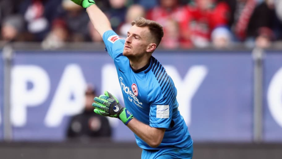 AUGSBURG, GERMANY - FEBRUARY 04: Goalkeeper Lukas Hradecky of Frankfurt throws the ball during the Bundesliga match between FC Augsburg and Eintracht Frankfurt at WWK-Arena on February 4, 2018 in Augsburg, Germany.  (Photo by Alex Grimm/Bongarts/Getty Images)