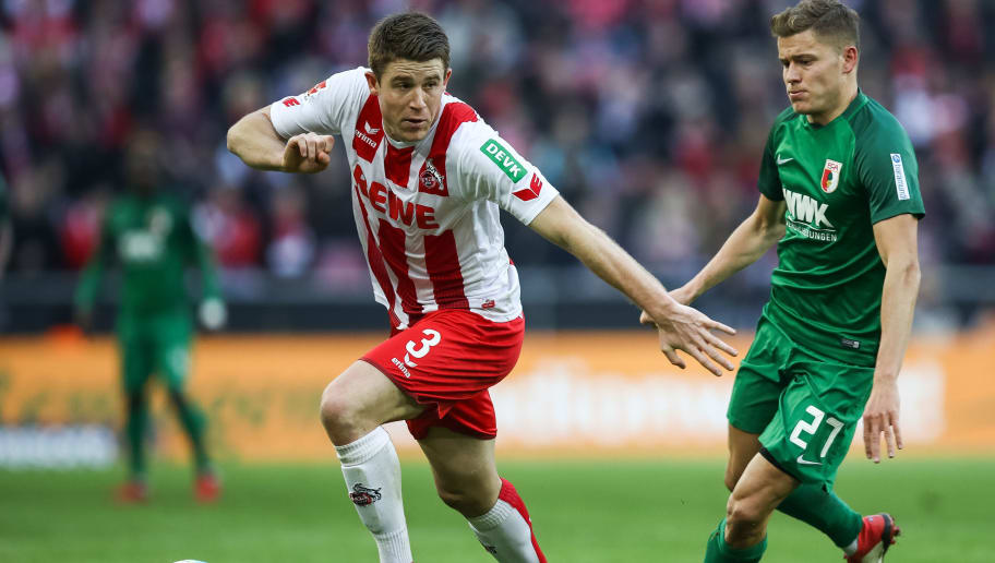 COLOGNE, GERMANY - JANUARY 27: Dominique Heintz #3 of 1.FC Koeln and Alfred Finnbogason #27 of Augsburg battle for the ball during the Bundesliga match between 1. FC Koeln and FC Augsburg at RheinEnergieStadion on January 27, 2018 in Cologne, Germany. (Photo by Maja Hitij/Bongarts/Getty Images)