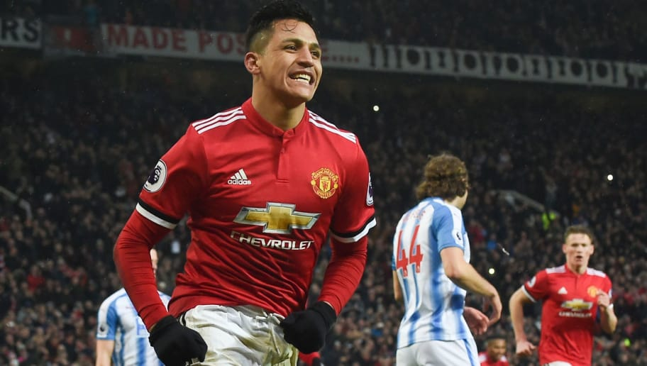 TOPSHOT - Manchester United's Chilean striker Alexis Sanchez celebrates scoring their second goal during the English Premier League football match between Manchester United and Huddersfield Town at Old Trafford in Manchester, north west England, on February 3, 2018. / AFP PHOTO / PAUL ELLIS / RESTRICTED TO EDITORIAL USE. No use with unauthorized audio, video, data, fixture lists, club/league logos or 'live' services. Online in-match use limited to 75 images, no video emulation. No use in betting, games or single club/league/player publications.  /         (Photo credit should read PAUL ELLIS/AFP/Getty Images)