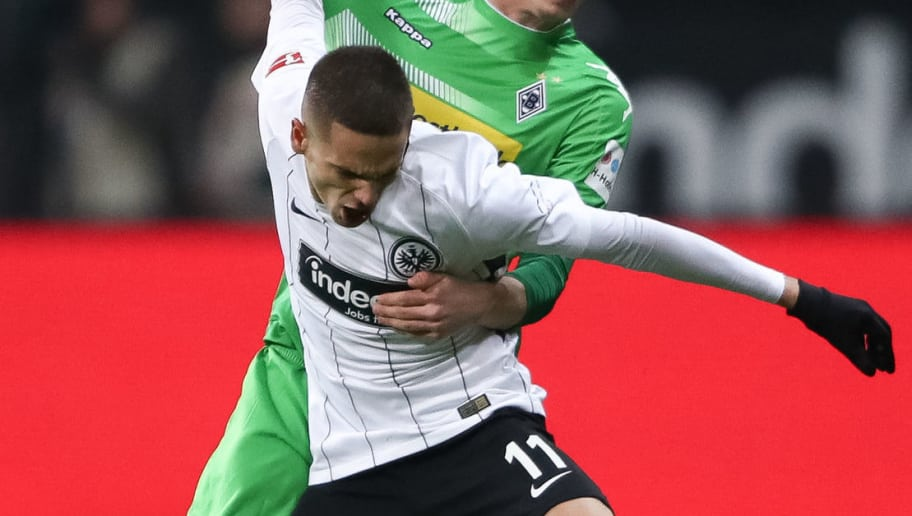 FRANKFURT AM MAIN, GERMANY - JANUARY 26: Mijat Gacinovic #11 of Eintracht Frankfurt and Michael Cuisance of Moenchengladbach battle for the ball during the Bundesliga match between Eintracht Frankfurt and Borussia Moenchengladbach at Commerzbank-Arena on January 26, 2018 in Frankfurt am Main, Germany. (Photo by Alex Grimm/Bongarts/Getty Images)