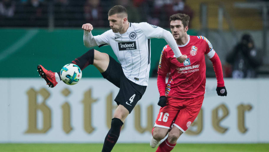 FRANKFURT AM MAIN, GERMANY - FEBRUARY 07: Ante Rebic of Frankfurt is challenged by Stefan Bell of Mainz during the DFB Cup quarter final match between Eintracht Frankfurt and 1. FSV Mainz 05 at Commerzbank-Arena on February 7, 2018 in Frankfurt am Main, Germany. (Photo by Simon Hofmann/Bongarts/Getty Images)