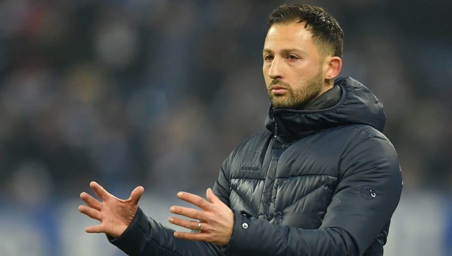 GELSENKIRCHEN, GERMANY - FEBRUARY 07:  Domenico Tedesco, head coach of Schalke reacts during the DFB Pokal quarter final match between FC Schalke 04 and VfL Wolfsburg at Veltins-Arena on February 7, 2018 in Gelsenkirchen, Germany.  (Photo by Stuart Franklin/Bongarts/Getty Images)
