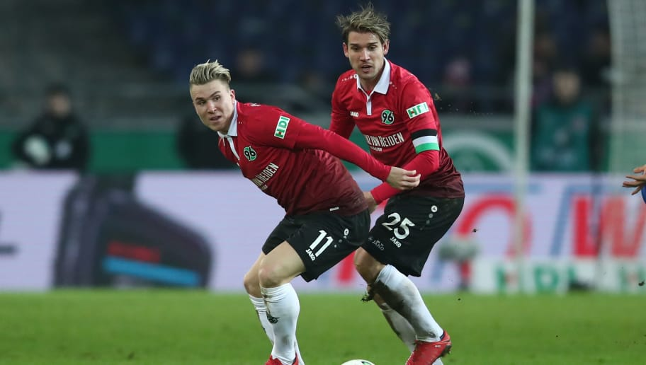 HANOVER, GERMANY - JANUARY 13:  (L-R) Felix Klaus and Oliver Sorg of Hannover in action during the Bundesliga match between Hannover 96 and 1. FSV Mainz 05 at HDI-Arena on January 13, 2018 in Hanover, Germany.  (Photo by Oliver Hardt/Bongarts/Getty Images)