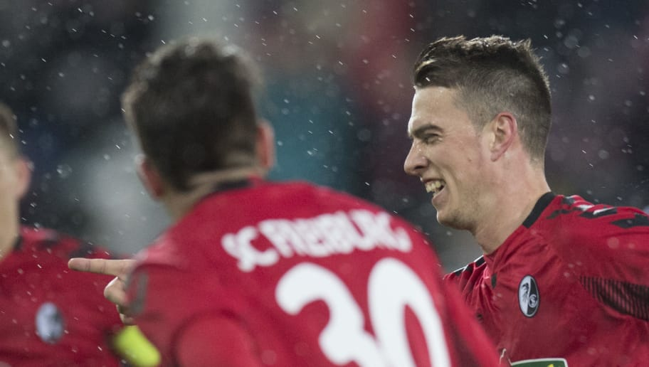 Freiburg's German defender Robin Koch (R) celebrates with teammates after scoring the 2-1 during the German first division Bundesliga football match SC Freiburg vs RB Leipzig in Freiburg, southwestern Germany, on January 20, 2018. / AFP PHOTO / THOMAS KIENZLE / RESTRICTIONS: DURING MATCH TIME: DFL RULES TO LIMIT THE ONLINE USAGE TO 15 PICTURES PER MATCH AND FORBID IMAGE SEQUENCES TO SIMULATE VIDEO. == RESTRICTED TO EDITORIAL USE == FOR FURTHER QUERIES PLEASE CONTACT DFL DIRECTLY AT + 49 69 650050         (Photo credit should read THOMAS KIENZLE/AFP/Getty Images)