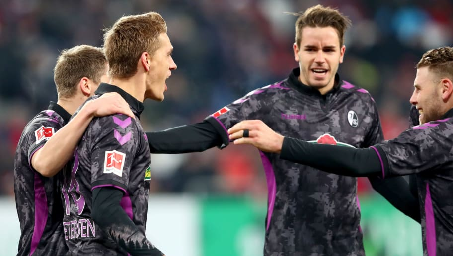 AUGSBURG, GERMANY - DECEMBER 16:  Nils Petersen (2nd L) of Freiburg celebrates scoring the 2nd team goal witrh his team mates during the Bundesliga match between FC Augsburg and Sport-Club Freiburg at WWK-Arena on December 16, 2017 in Augsburg, Germany.  (Photo by Alexander Hassenstein/Bongarts/Getty Images)