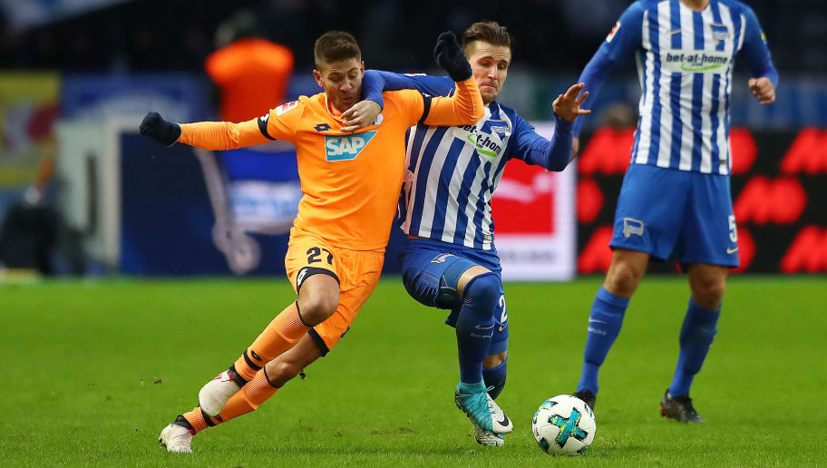 BERLIN, GERMANY - FEBRUARY 03: Andrej Kramaric of Hoffenheim (l) fights for the ball with Peter Pekarik of Berlin during the Bundesliga match between Hertha BSC and TSG 1899 Hoffenheim at Olympiastadion on February 3, 2018 in Berlin, Germany. (Photo by Martin Rose/Bongarts/Getty Images)