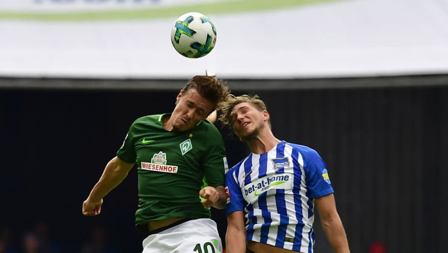Berlin's German defender Niklas Stark (R) and Bremen's German forward Max Kruse vie for the ball during German first division Bundesliga football match between Hertha Berlin and Werder Bremen on September 10, 2017 in Berlin, Germany. / AFP PHOTO / Tobias SCHWARZ / RESTRICTIONS: DURING MATCH TIME: DFL RULES TO LIMIT THE ONLINE USAGE TO 15 PICTURES PER MATCH AND FORBID IMAGE SEQUENCES TO SIMULATE VIDEO. == RESTRICTED TO EDITORIAL USE == FOR FURTHER QUERIES PLEASE CONTACT DFL DIRECTLY AT + 49 69 650050         (Photo credit should read TOBIAS SCHWARZ/AFP/Getty Images)