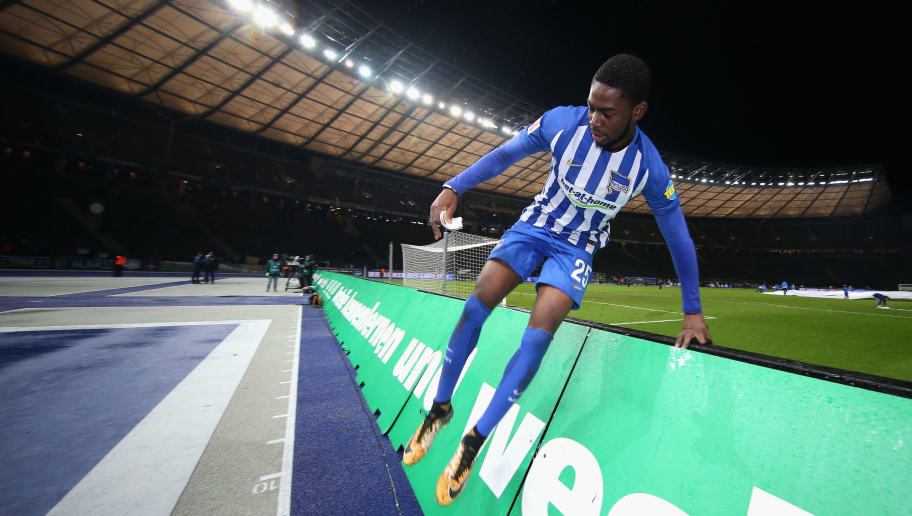 BERLIN, GERMANY - DECEMBER 13:  Jordan Torunarigha of Hertha BSC jumps over the LED boards to celebrate with his fans after winning the Bundesliga match between Hertha BSC and Hannover 96 at Olympiastadion on December 13, 2017 in Berlin, Germany.  (Photo by Boris Streubel/Bongarts/Getty Images )