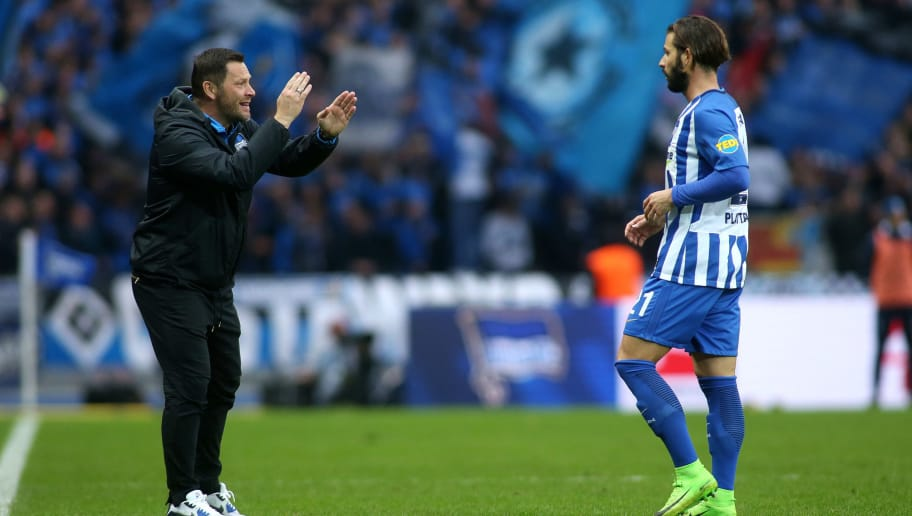 BERLIN, GERMANY - OCTOBER 28: Head coach Pal Dardai of Hertha BSC (L) talks to Marvin Plattenhardt of Hertha BSC during the Bundesliga match between Hertha BSC and Hamburger SV at Olympiastadion on October 28, 2017 in Berlin, Germany. (Photo by Selim Sudheimer/Bongarts/Getty Images )
