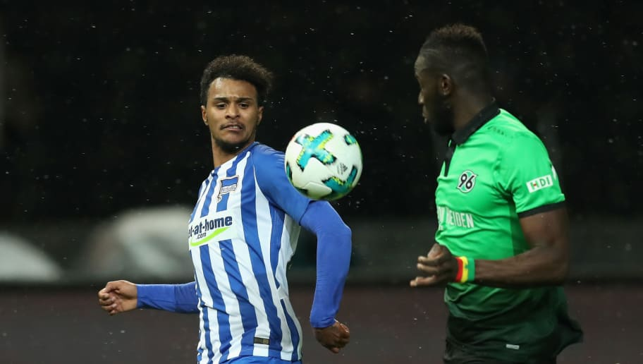 BERLIN, GERMANY - DECEMBER 13:  Valentino Lazaro of Hertha BSC battles for the ball with Salif Sane of Hannover 96 during the Bundesliga match between Hertha BSC and Hannover 96 at Olympiastadion on December 13, 2017 in Berlin, Germany.  (Photo by Boris Streubel/Bongarts/Getty Images )