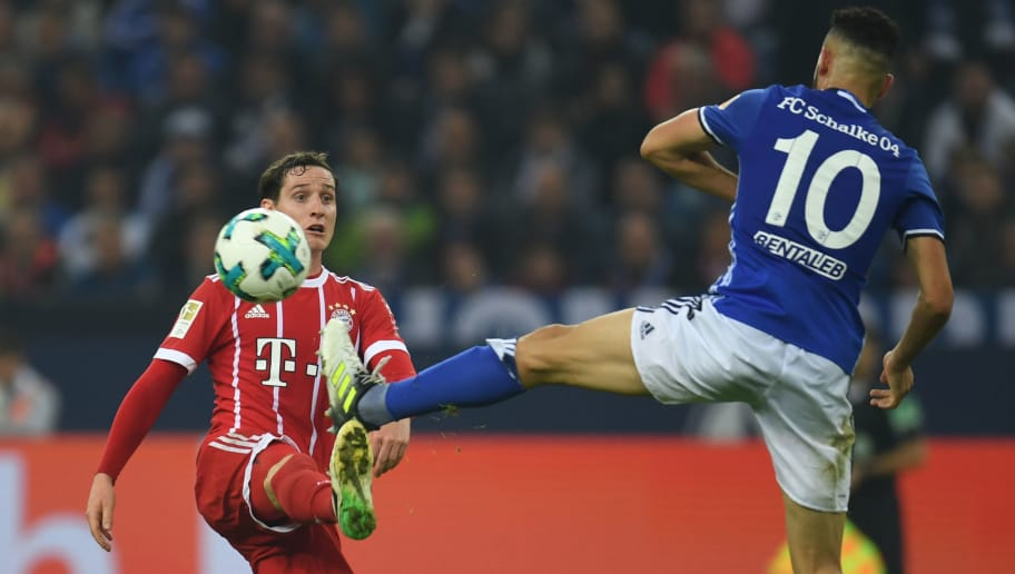 Bayern Munich's German midfielder Sebastian Rudy (L) and Schalke's Algerian midfielder Nabil Bentaleb vie for the ball  during the German First division Bundesliga football match between FC Schalke 04 and FC Bayern Munich in Gelsenkirchen, western Germany, on September 19, 2017. / AFP PHOTO / PATRIK STOLLARZ / RESTRICTIONS: DURING MATCH TIME: DFL RULES TO LIMIT THE ONLINE USAGE TO 15 PICTURES PER MATCH AND FORBID IMAGE SEQUENCES TO SIMULATE VIDEO. == RESTRICTED TO EDITORIAL USE == FOR FURTHER QUERIES PLEASE CONTACT DFL DIRECTLY AT + 49 69 650050         (Photo credit should read PATRIK STOLLARZ/AFP/Getty Images)