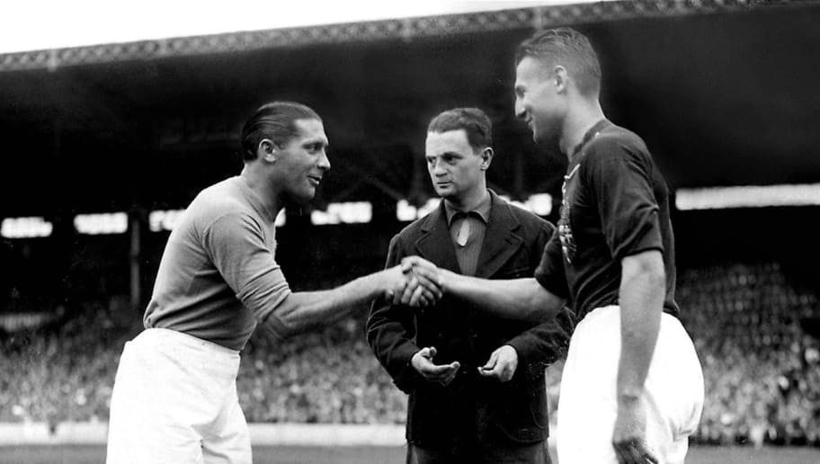 COLOMBES, FRANCE - JUNE 19:  French referee Georges Capdeville (C) looks on as the captains of the Italian and Hungarian national soccer teams Giuseppe Meazza (L) and Gyorgy Sarosi shake hands before the start of the World Cup final between the two countries, 19 June 1938 in Colombes, in the suburbs of Paris.  AFP PHOTO  (Photo credit should read STAFF/AFP/Getty Images)