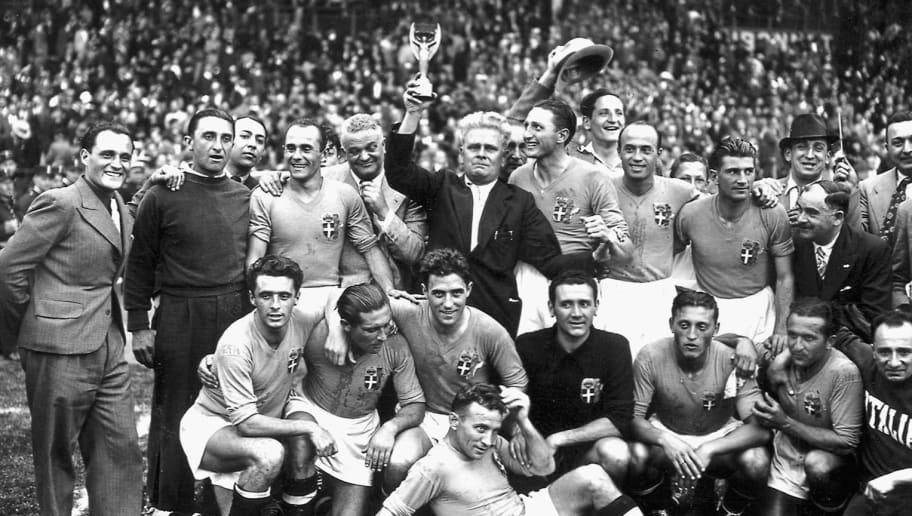 Italy's national soccer team poses with the World Cup trophy after beating Hungary 4-2 in the World Cup final, 19 June 1938 in Colombes, in the suburbs of Paris.(Standing from L : Amadeo Biavati (4th L), coach Vittorio Pozzo holding the trophy, Silvio Piola, Giovanni Ferrari, Gino Colaussi; first row, from L : Ugo Locatelli, Giuseppe Meazza, Alfredo Foni, Pietro Serantoni, Aldo Olivieri, Pietro Rava and Michele Andreolo) / AFP PHOTO / STAFF        (Photo credit should read STAFF/AFP/Getty Images)