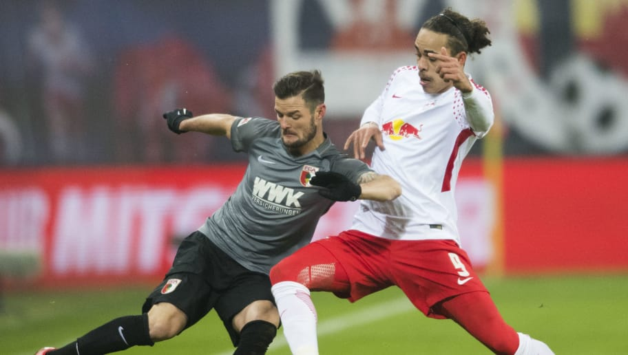 Leipzig´s Danish forward Yussuf Poulsen (R) and Augsburgs´s midfielder Marcel Heller vie for the ball during the German first division Bundesliga football match between RB Leipzig and FC Augsburg in Leipzig, eastern Germany on February 9, 2018.  / AFP PHOTO / ROBERT MICHAEL        (Photo credit should read ROBERT MICHAEL/AFP/Getty Images)