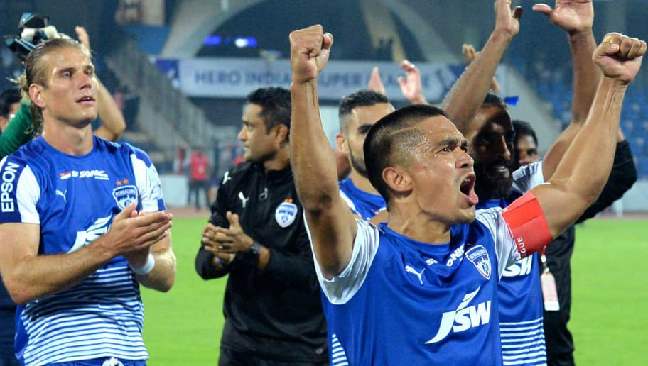 Bengaluru FC captain Sunil Chhetri (R) celebrates with his teammates after victory in the Hero ISL football match between BFC and ATK at The Shree Kanteerava Stadium in Bangalore on January 7, 2018. / AFP PHOTO / Manjunath KIRAN / RESTRICTED TO EDITORIAL USE        (Photo credit should read MANJUNATH KIRAN/AFP/Getty Images)