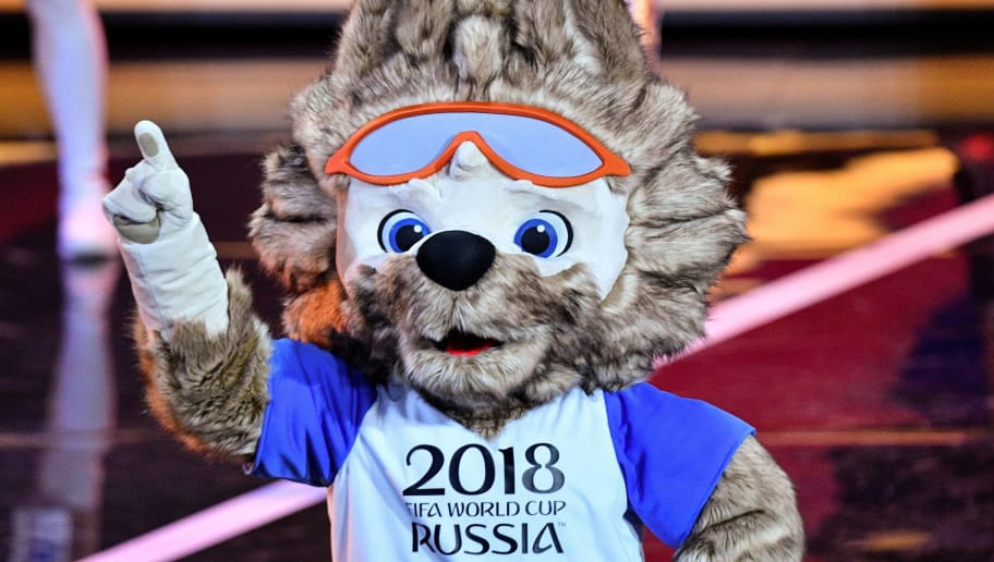 A performer dressed as Zabivaka, the official mascot for the 2018 FIFA World Cup, gestures on stage  during the Final Draw for the 2018 FIFA World Cup football tournament at the State Kremlin Palace in Moscow on December 1, 2017. The 2018 FIFA World Cup will be held from June 14 and July 15, 2018, in 11 Russian cities. / AFP PHOTO / Mladen ANTONOV        (Photo credit should read MLADEN ANTONOV/AFP/Getty Images)