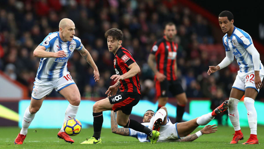 BOURNEMOUTH, ENGLAND - NOVEMBER 18:  Aaron Mooy of Huddersfield Town moves away from Harry Arter of AFC Bournemouth during the Premier League match between AFC Bournemouth and Huddersfield Town at Vitality Stadium on November 18, 2017 in Bournemouth, England.  (Photo by Dan Istitene/Getty Images)