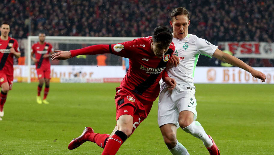 LEVERKUSEN, GERMANY - FEBRUARY 06: Ludwig Augustinsson of Bremen (R) challenges Kai Havertz of Leverkusen (L) during the DFB Cup quarter final match between Bayer Leverkusen and Werder Bermen at BayArena on February 6, 2018 in Leverkusen, Germany. (Photo by Christof Koepsel/Bongarts/Getty Images)