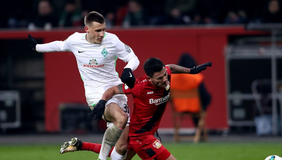 LEVERKUSEN, GERMANY - FEBRUARY 06: Charles Aranguiz (R) of Leverkusen is tackled by Maximilian Eggestein of Bremen during the DFB Cup quarter final match between Bayer Leverkusen and Werder Bremen at BayArena on February 6, 2018 in Leverkusen, Germany.  (Photo by Alex Grimm/Bongarts/Getty Images)