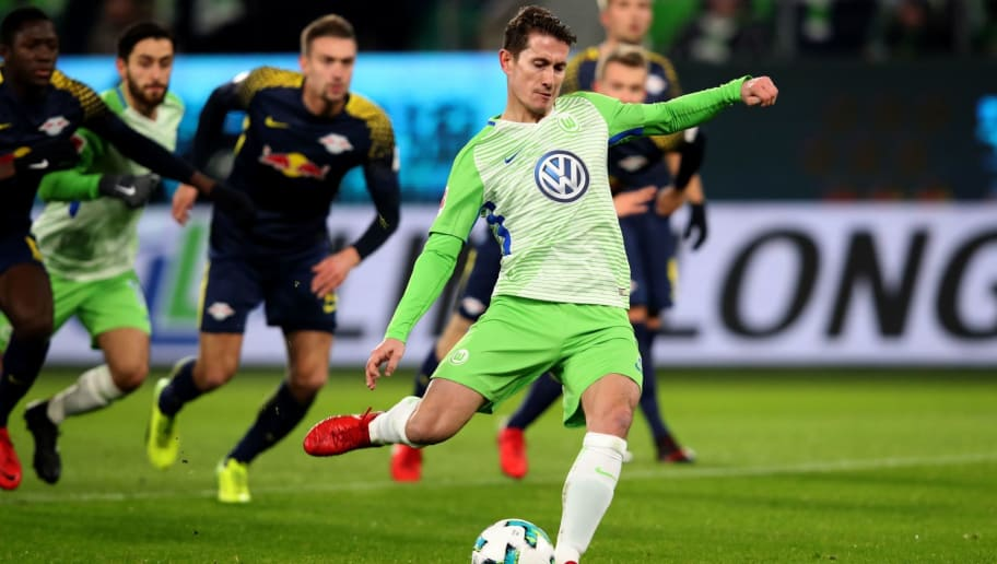 Wolfsburg's Dutch defender Paul Verhaegh (C) kicks the ball before scoring a penalty during the German first division Bundesliga football match between VfL Wolfsburg and RB Leipzig on December 12, 2017 in Wolfsburg. / AFP PHOTO / Ronny Hartmann / RESTRICTIONS: DURING MATCH TIME: DFL RULES TO LIMIT THE ONLINE USAGE TO 15 PICTURES PER MATCH AND FORBID IMAGE SEQUENCES TO SIMULATE VIDEO. == RESTRICTED TO EDITORIAL USE == FOR FURTHER QUERIES PLEASE CONTACT DFL DIRECTLY AT + 49 69 650050         (Photo credit should read RONNY HARTMANN/AFP/Getty Images)