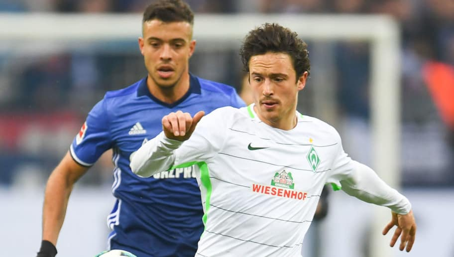 Bremen's Danish midfielder Thomas Delaney and Schalke's Argentinian forward Franco di Santo vie for the ball during the German first division Bundesliga football match FC Schalke 04 vs Werder Bremen, in Gelsenkirchen, western Germany, on February 3, 2018. / AFP PHOTO / Patrik STOLLARZ / RESTRICTIONS: DURING MATCH TIME: DFL RULES TO LIMIT THE ONLINE USAGE TO 15 PICTURES PER MATCH AND FORBID IMAGE SEQUENCES TO SIMULATE VIDEO. == RESTRICTED TO EDITORIAL USE == FOR FURTHER QUERIES PLEASE CONTACT DFL DIRECTLY AT + 49 69 650050         (Photo credit should read PATRIK STOLLARZ/AFP/Getty Images)