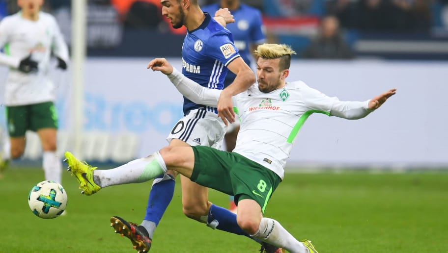 Bremen's German midfielder Jerome Gondorf and Schalke's Algerian midfielder Nabil Bentaleb vie for the ball during the German first division Bundesliga football match FC Schalke 04 vs Werder Bremen, in Gelsenkirchen, western Germany, on February 3, 2018. / AFP PHOTO / Patrik STOLLARZ / RESTRICTIONS: DURING MATCH TIME: DFL RULES TO LIMIT THE ONLINE USAGE TO 15 PICTURES PER MATCH AND FORBID IMAGE SEQUENCES TO SIMULATE VIDEO. == RESTRICTED TO EDITORIAL USE == FOR FURTHER QUERIES PLEASE CONTACT DFL DIRECTLY AT + 49 69 650050         (Photo credit should read PATRIK STOLLARZ/AFP/Getty Images)