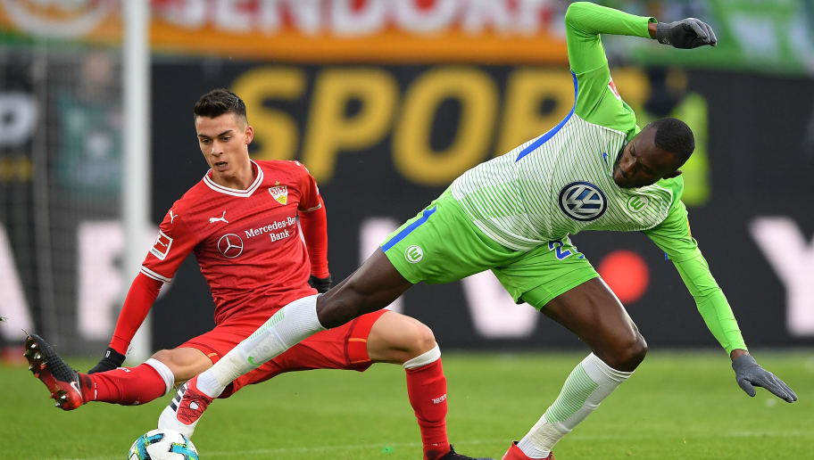 WOLFSBURG, GERMANY - FEBRUARY 03: Joshua Guilavogui of Wolfsburg (r) fights for the ball with Erik Thommy of Stuttgart during the Bundesliga match between VfL Wolfsburg and VfB Stuttgart at Volkswagen Arena on February 3, 2018 in Wolfsburg, Germany. (Photo by Stuart Franklin/Bongarts/Getty Images)
