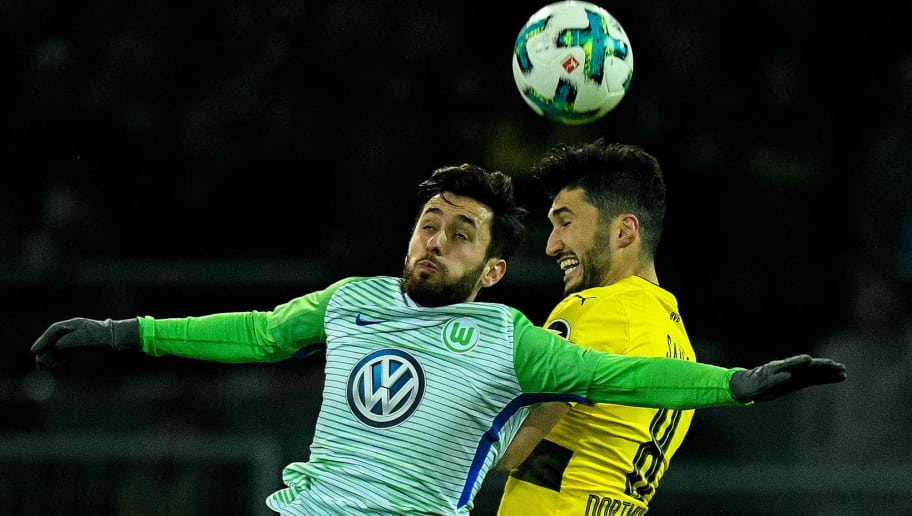 Dortmund's Turkish midfielder Nuri Sahin (R) and Wolfsburg's midfielder Yunus Malli vie for the ball during the German first division Bundesliga football match BVB Borussia Dortmund vs VfL Wolfsburg, in Dortmund, western Germany, on January 14, 2018. / AFP PHOTO / SASCHA SCHUERMANN / RESTRICTIONS: DURING MATCH TIME: DFL RULES TO LIMIT THE ONLINE USAGE TO 15 PICTURES PER MATCH AND FORBID IMAGE SEQUENCES TO SIMULATE VIDEO. == RESTRICTED TO EDITORIAL USE == FOR FURTHER QUERIES PLEASE CONTACT DFL DIRECTLY AT + 49 69 650050         (Photo credit should read SASCHA SCHUERMANN/AFP/Getty Images)
